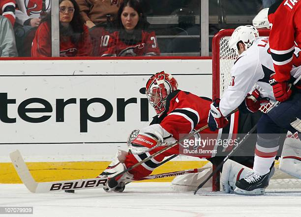 Johan Hedberg of the New Jersey Devils makes the save in route to a 50 shut out of the Washington Capitals at the Prudential Center on November 22...