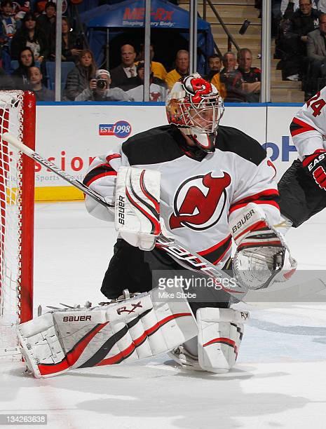 Johan Hedberg of the New Jersey Devils skates against the New York Islanders at Nassau Veterans Memorial Coliseum on November 25 2011 in Uniondale...