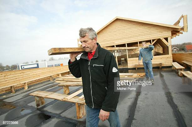 Johan Huibers and his son Roy are at work on their 70metrelong Noah's Ark replica constructed of steel and American cedar as it lies to be finished...