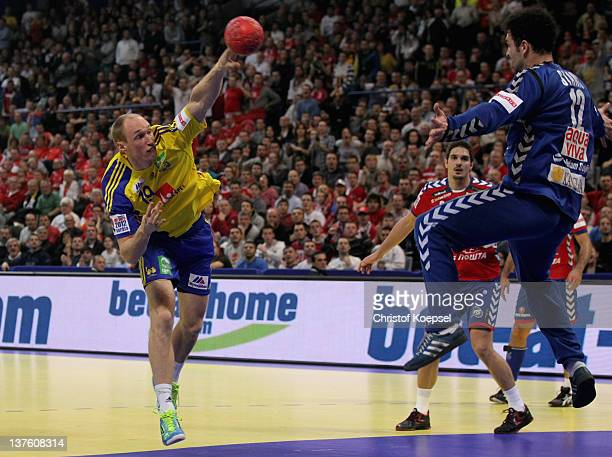 Johan Jakobsson of Sweden scores a goal against Dragan Marjanac of Serbia during the Men's European Handball Championship second round group one...