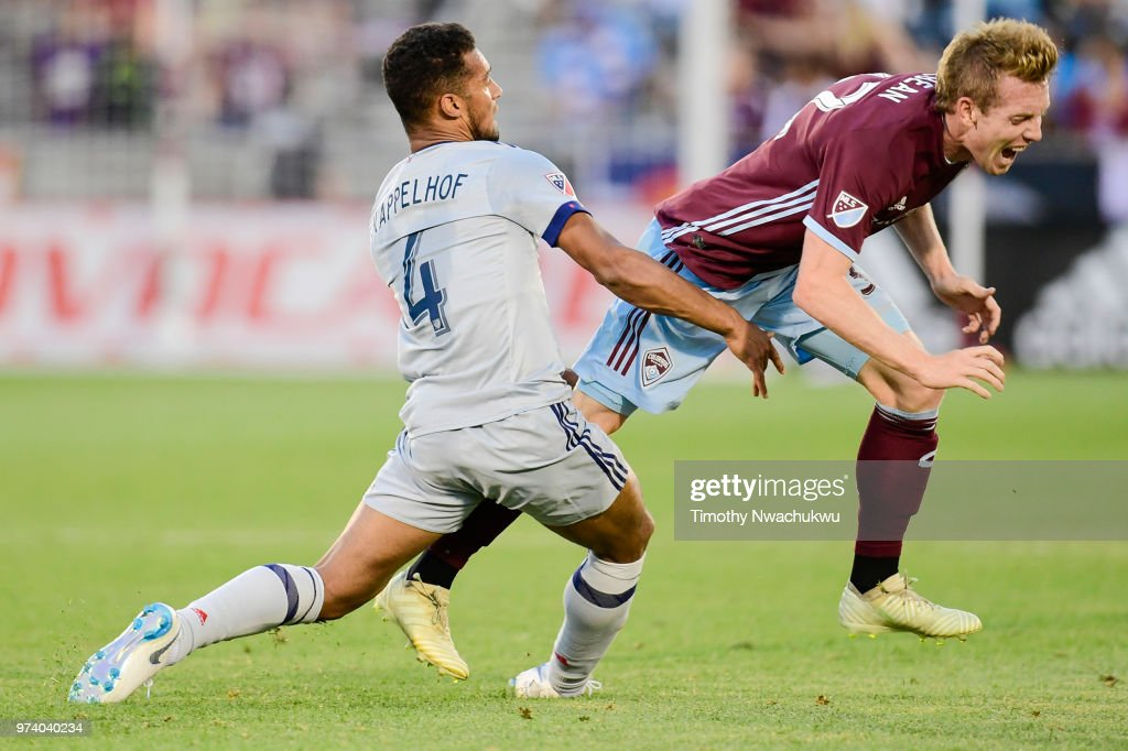 Johan Kappelhof #4 of Chicago Fire makes contact with Jack McBean #32 of Colorado Rapids at Dick's Sporting Goods Park on June 13, 2018 in Commerce City, Colorado.
