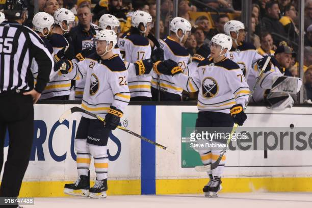 Johan Larsson and Evan Rodrigues of the Buffalo Sabres celebrate a goal against the Boston Bruins at the TD Garden on February 10 2018 in Boston...