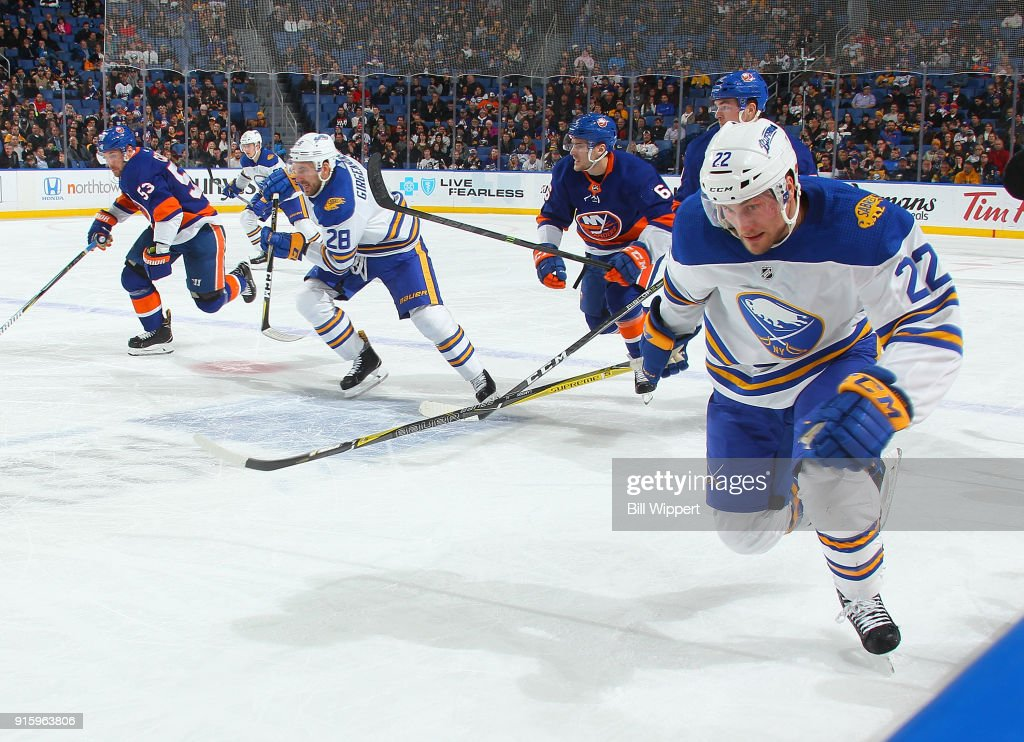 Johan Larsson #22 and Zemgus Girgensons #28 of the Buffalo Sabres skate for the puck against the New York Islanders during an NHL game on February 8, 2018 at KeyBank Center in Buffalo, New York. Buffalo won, 4-3.