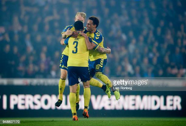 Johan Larsson Anthony Jung and Hany Mukhtar of Brondby IF celebrate after scoring their third goal during celebrates after scoring their third goal...