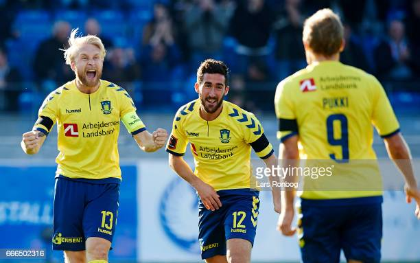 Johan Larsson Frederik Holst and Teemu Pukki of Brondby IF celebrate after scoring their second goal during the Danish Alka Superliga match between...