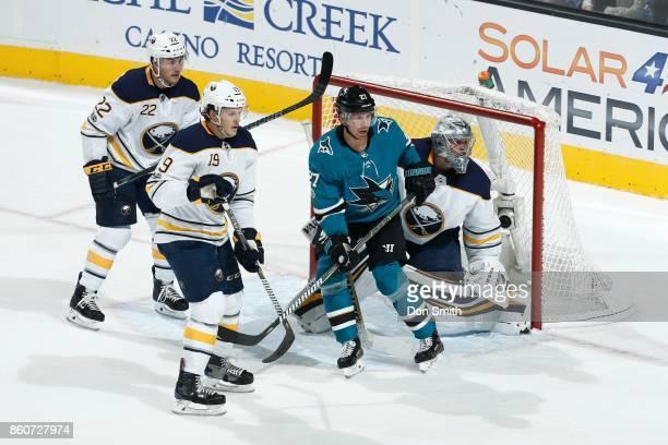 Johan Larsson Jake McCabe and Robin Lehner of the Buffalo Sabres defend against Joonas Donskoi of the San Jose Sharks at SAP Center at San Jose on...