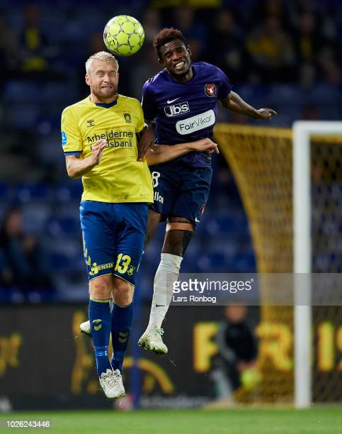 Johan Larsson of Brondby IF and Frank Onyeka of FC Midtjylland compete for the ball during the Danish Superliga match between Brondby IF and FC...