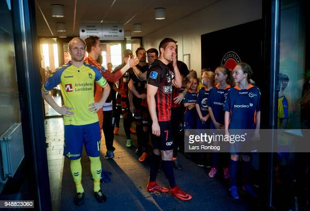 Johan Larsson of Brondby IF and Jakob Poulsen of FC Midtjylland waiting to lead there teams on to the pitch prior to the Danish Alka Superliga match...
