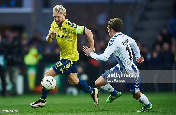 Johan Larsson of Brondby IF and Jens Jakob Thomasen of OB Odense compete for the ball during the Danish Alka Superliga match between Brondby IF and...