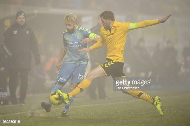 Johan Larsson of Brondby IF and Mathias Nielsen of AC Horsens compete for the ball during the Danish Alka Superliga match between AC Horsens and...
