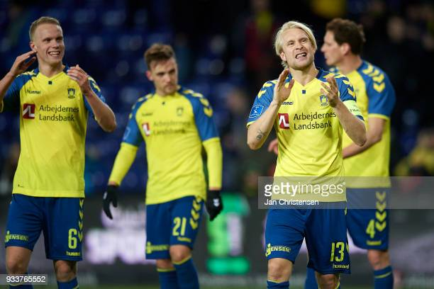 Johan Larsson of Brondby IF and teammates celebrate after the Danish Alka Superliga match between Brondby IF and Hobro IK at Brondby Stadion on March...
