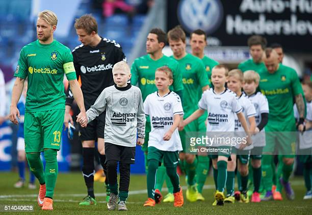 Johan Larsson of Brondby IF and teammates walk on to the pitch prior to the Danish Alka Superliga match between SonderjyskE and Brondby IF at Sydbank...