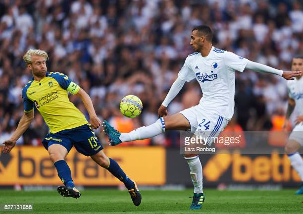Johan Larsson of Brondby IF and Youssef Toutouh of FC Copenhagen compete for the ball during the Danish Alka Superliga match between Brondby IF and...