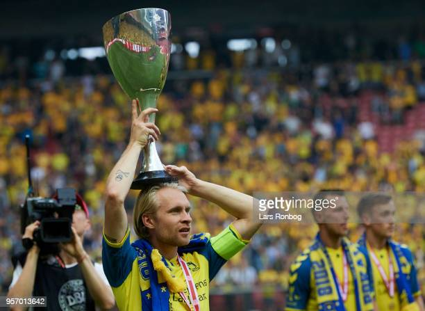 Johan Larsson of Brondby IF celebrates with the trophy winning the cupfinal after the Danish DBU Pokalen Cup Final match between Brondby IF and...