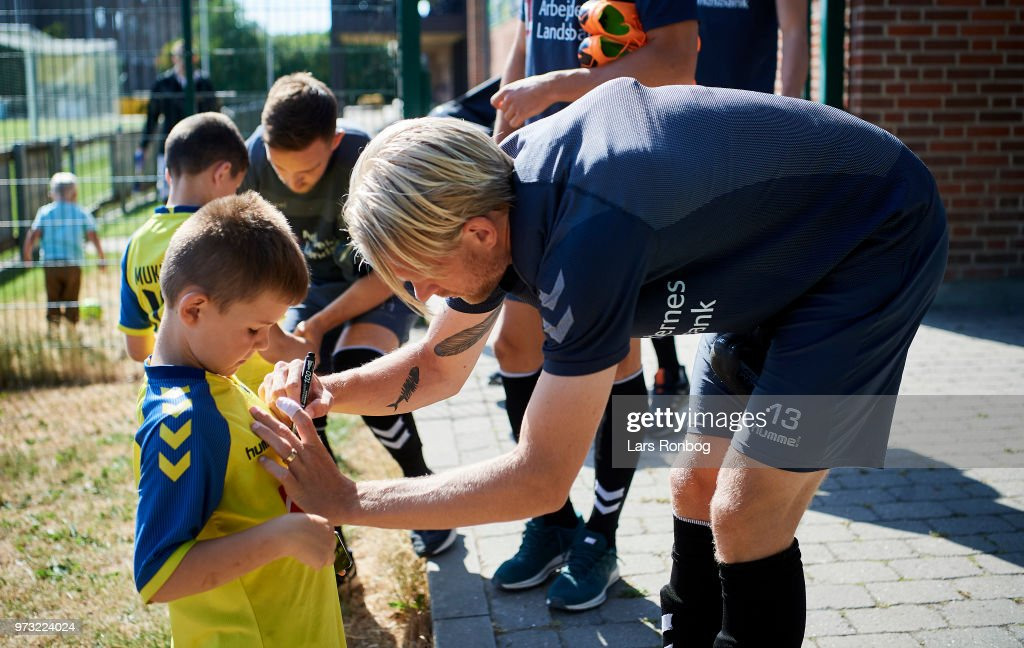 Johan Larsson of Brondby IF signing an autograph for an young fan prior to the Brondby IF training session at Brondby Stadion on June 13, 2018 in Brondby, Denmark.