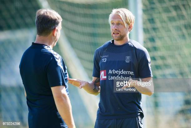 Johan Larsson of Brondby IF speaks to Alexander Zorniger head coach of Brondby IF prior to the Brondby IF training session at Brondby Stadion on June...
