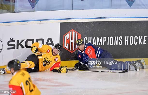 Johan Larsson of SaiPa Lappeenranta and John Laliberte of ERC Ingolstadt liegen on Boden during the Champions Hockey League game between ERC...