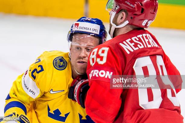 Johan Larsson of Sweden and Nikita Nesterov of Russia vie during the group A match Russia v Sweden of the 2018 IIHF Ice Hockey World Championship at...