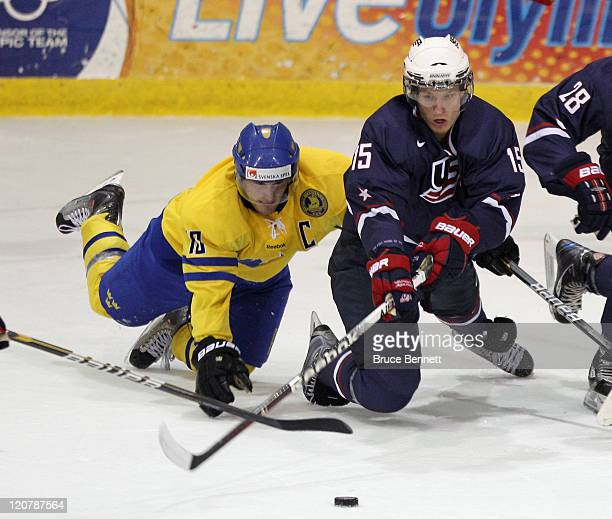 Johan Larsson of Team Sweden gets tripped up while chasing Nick Bjugstad of Team USA at the Lake Placid Olympic Center on August 10, 2011 in Lake...