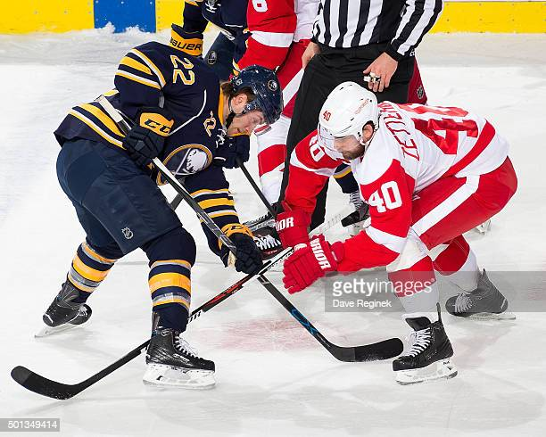 Johan Larsson of the Buffalo Sabres faces off against Henrik Zetterberg of the Detroit Red Wings during an NHL game at Joe Louis Arena on December 14...