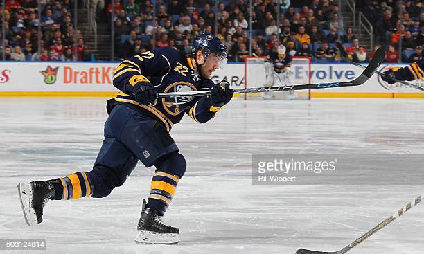 Johan Larsson of the Buffalo Sabres shoots the puck against the Chicago Blackhawks during an NHL game on December 19 2015 at the First Niagara Center...