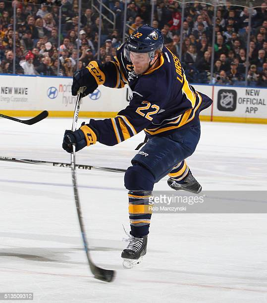 Johan Larsson of the Buffalo Sabres shoots the puck against the Pittsburgh Penguins during an NHL game on February 21 2016 at the First Niagara...