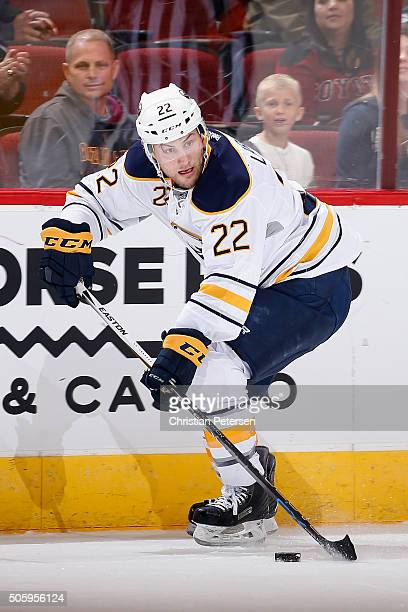Johan Larsson of the Buffalo Sabres skates with the puck during the NHL game against the Arizona Coyotes at Gila River Arena on January 18 2016 in...
