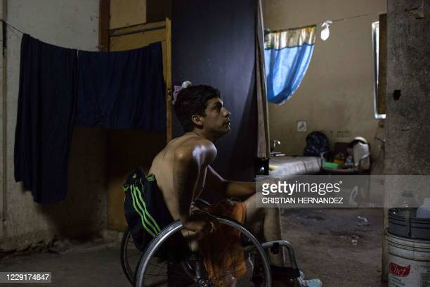 Johan Medina is seen on his wheelchair by his room at a shelter located in the basement of the Sudameris public building in Caracas, on October 9...