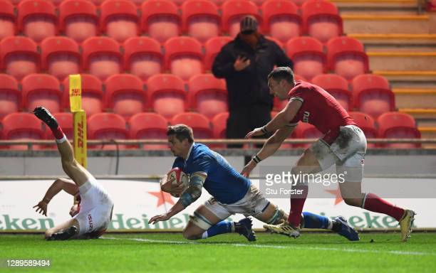 Johan Meyer of Italy goes over to score their second try under pressure from George North of Wales during the Autumn Nations Cup match between Wales...