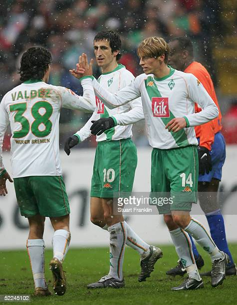Johan Micoud of Bremen celebrates scoring the fourth goal with Nelson Valdez and Aaron Hunt during The Bundesliga match between Werder Bremen and VfL...