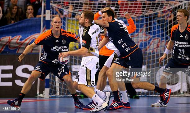 Johan Mikael Jakobsson of Flensburg challenges Steffen Weinhold of Kiel for the ball during the VELUX EHF Champions League Round of 16 first leg...
