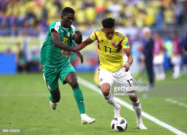 Johan Mojica of Colombia and Ismaila Sarr of Senegal compete for the ball during the 2018 FIFA World Cup Russia group H match between Senegal and...