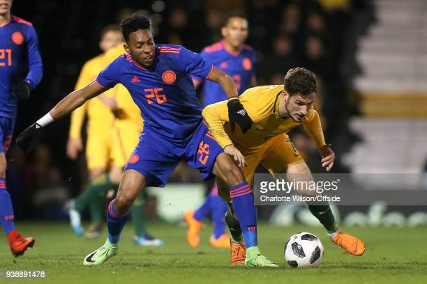 Johan Mojica of Colombia and Mathew Leckie of Australia battle for the ball during the International Friendly match between Australia and Colombia at...