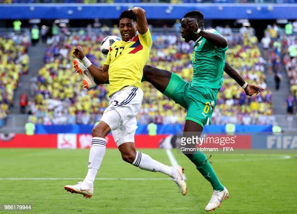 Johan Mojica of Colombia is challenged by Salif Sane of Senegal during the 2018 FIFA World Cup Russia group H match between Senegal and Colombia at...