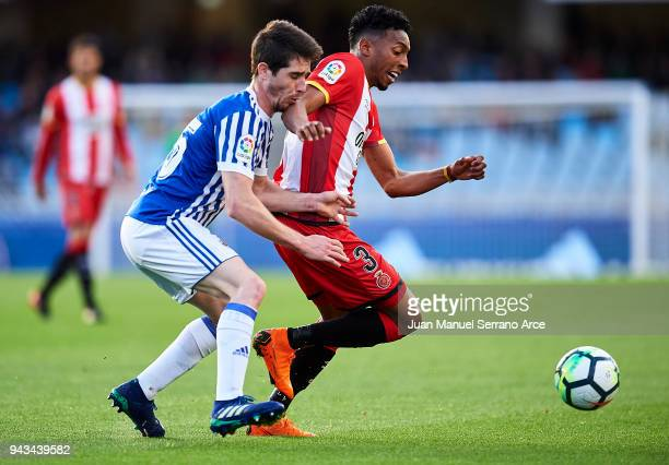 Johan Mojica of Girona FC duels for the ball with Aritz Elustondo of Real Sociedad during the La Liga match between Real Sociedad de Futbol and...