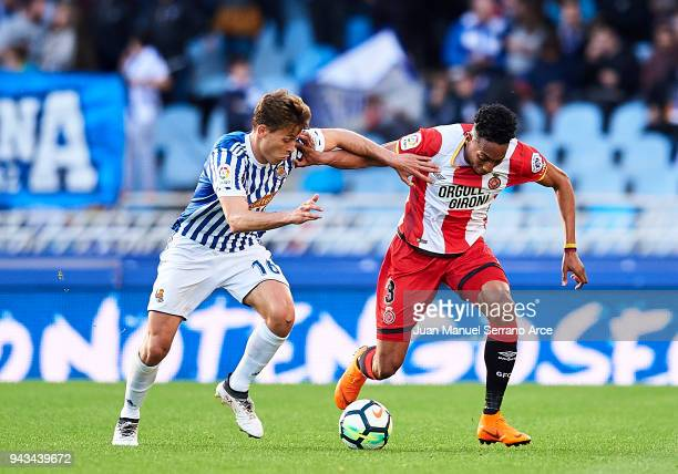 Johan Mojica of Girona FC duels for the ball with Sergio Canales of Real Sociedad during the La Liga match between Real Sociedad de Futbol and Girona...