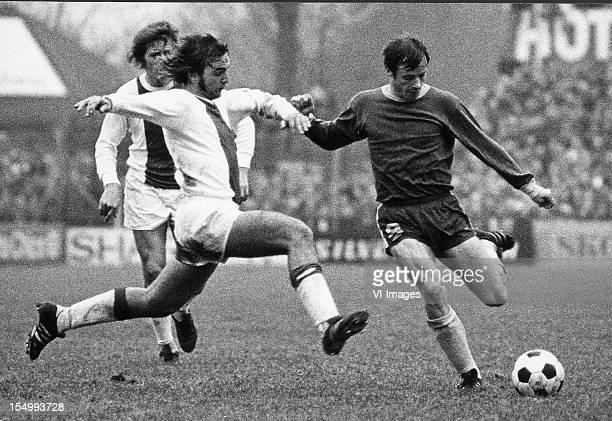 Johan Neeskens of Ajax Harald Berg of FC Den Haag during the Dutch Eredivisie match between FC Den Haag and Ajax at the Zuiderpark Stadium on january...
