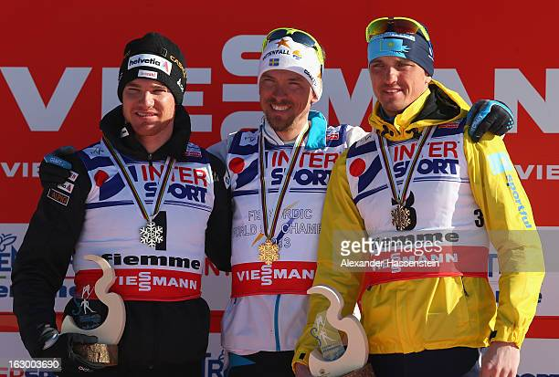 Johan Olsson of Sweden poses with his Gold medal, Dario Cologna of Switzerland his Silver medal and Alexey Poltoranin of Kazakhstan his Bronze medal...