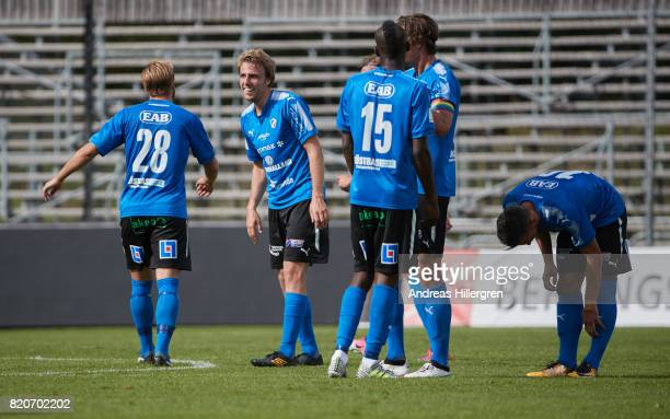 Johan Oremo of Halmstad BK celebrates after scoring 20 with Jesper Westerberg and Aboubakar Keita during the Allsvenskan match between Halmstad BK...