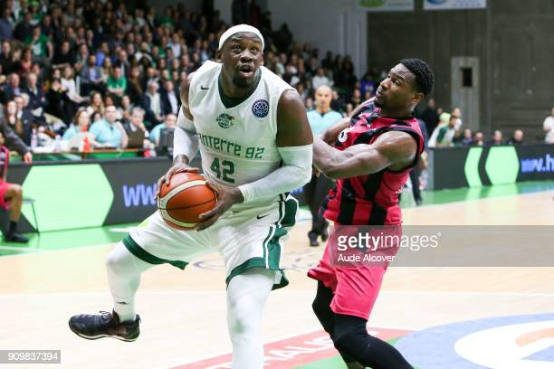 Johan Passave Ducteil of Nanterre and Yorman Polas Bartolo of Bonn during the Basket ball Champions League match between Nanterre and Bonn on January...