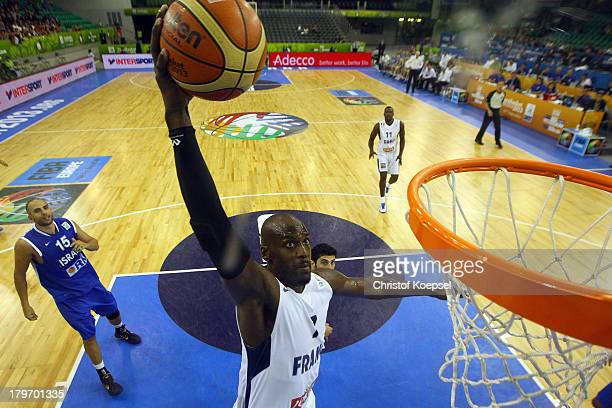 Johan Petro of France dunks the ball during the FIBA European Championships 2013 first round group A match between France and Israel at Tivoli Arena...