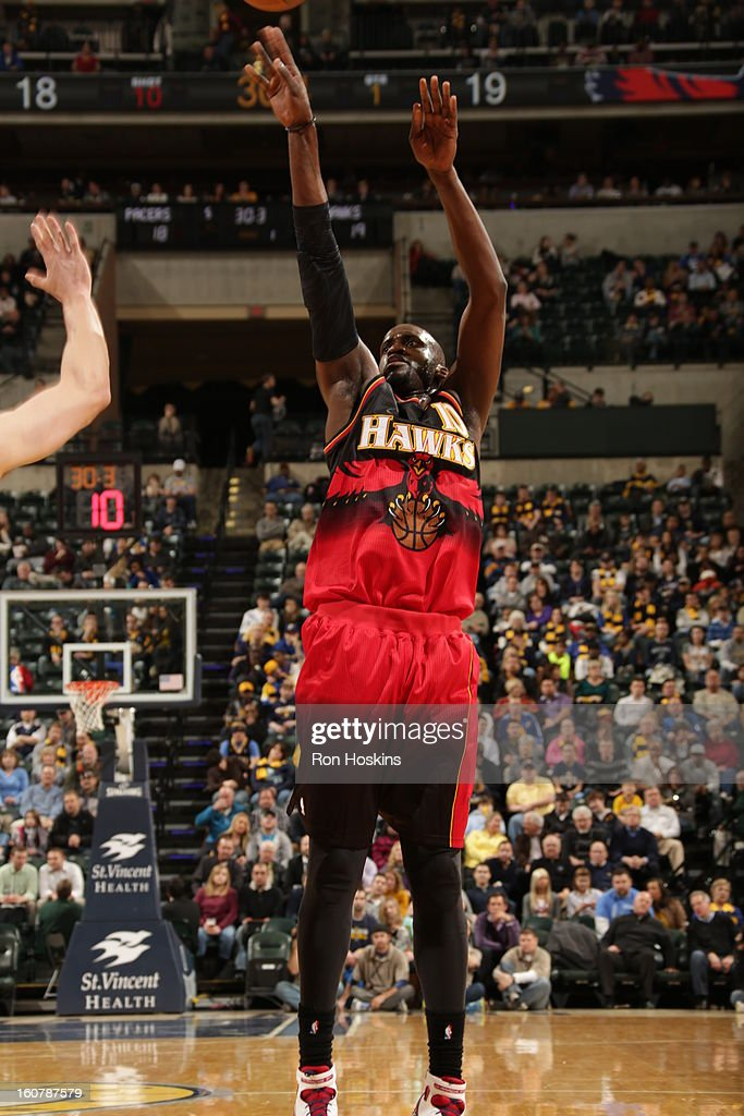 Johan Petro #10 of the Atlanta Hawks throws up the shot against the Indiana Pacers on February 5, 2013 at Bankers Life Fieldhouse in Indianapolis, Indiana.