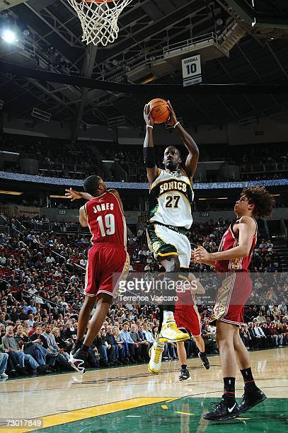 Johan Petro of the Seattle SuperSonics goes to the basket over the defense of Damon Jones of the Cleveland Cavaliers on January 16 2007 at the Key...