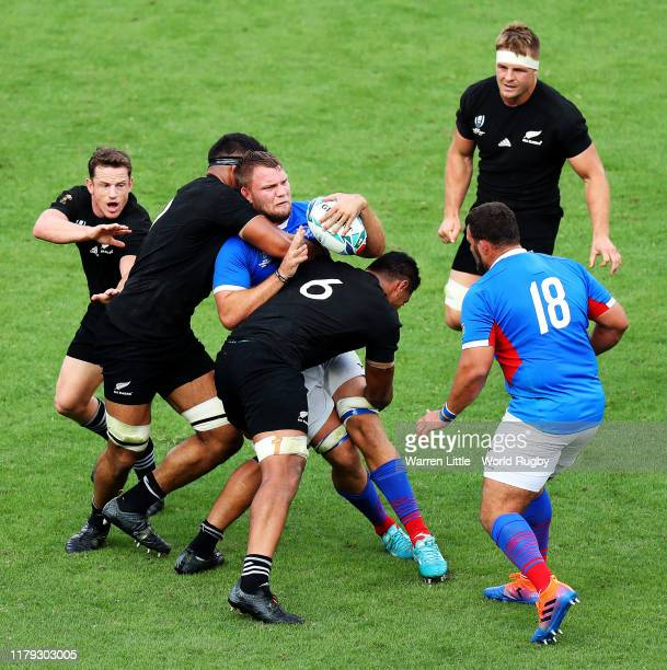 Johan Retief of Namibia is tackled during the Rugby World Cup 2019 Group B game between New Zealand and Namibia at Tokyo Stadium on October 06, 2019...