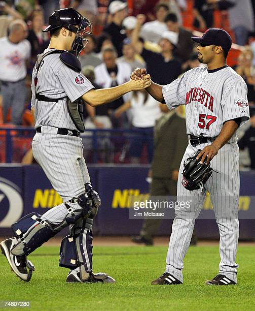 Johan Santana and Joe Mauer of the Minnesota Twins celebrate their 90 shutout victory against the New York Mets during their interleague game on June...