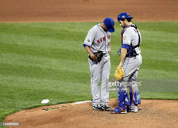 Johan Santana and Mike Nickeas of the New York Mets talk during a time out against the Pittsburgh Pirates during the game on May 21 2012 at PNC Park...