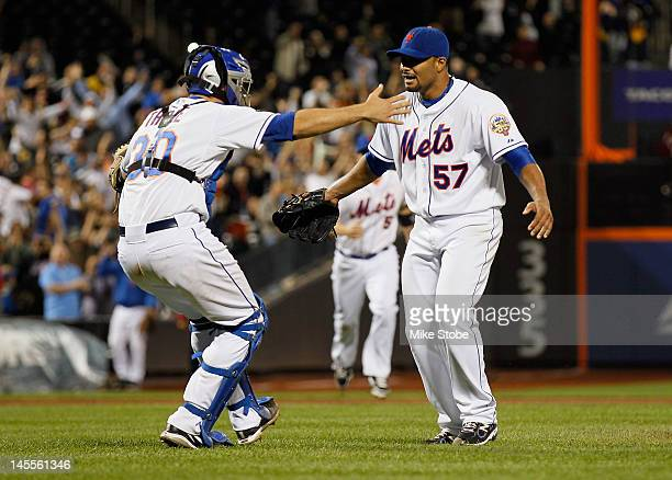 Johan Santana of the New York Mets celebrates with Josh Thole after pitching a no hitter against the St. Louis Cardinals at Citi Field on June 1,...