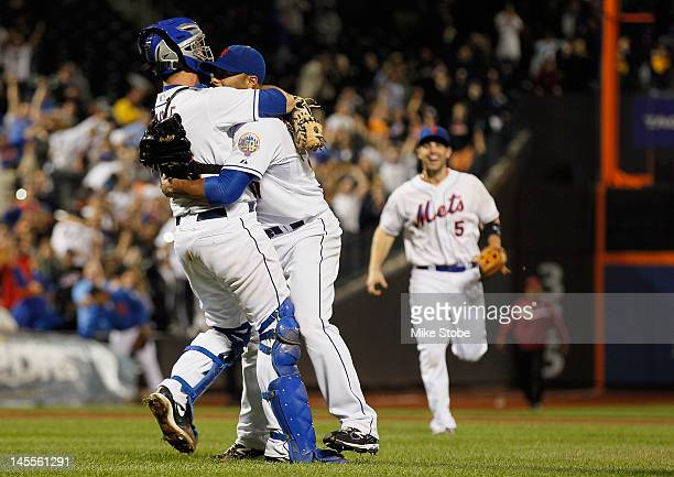 Johan Santana of the New York Mets celebrates with Josh Thole and David Wright after pitching a no hitter against the St. Louis Cardinals at Citi...