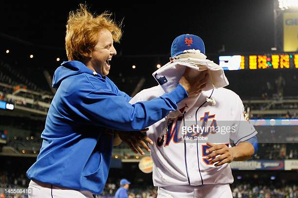Johan Santana of the New York Mets gets a shaving cream pie in the face from Justin Turner after pitching a no hitter against the St Louis Cardinals...