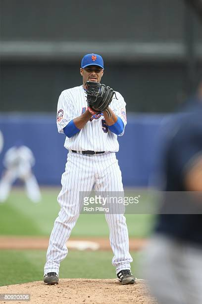 Johan Santana of the New York Mets pitches during the game against the Milwaukee Brewers at Shea Stadium in Flushing New York on April 12 2008 The...